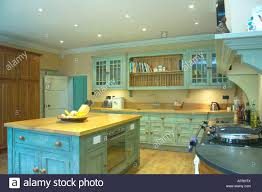traditional kitchen with turquoise distressed paint effect