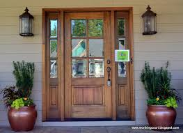 front door with sidelights oversized exterior lights and filled