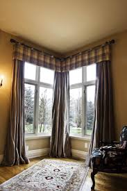 Bay Window Treatment Ideas by Decorations Interesting Bay Window Seat With Stripes Sheets And