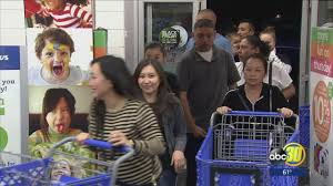 shoppers skip out on thanksgiving celebrations to hit black friday