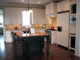 white kitchen island with black granite top black kitchen island hermelin me