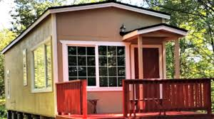 tiny house park model front porch large living full sized kitchen
