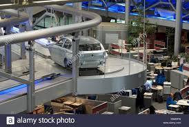bmw factory assembly line bmw body shells are transported along the assembly line above the