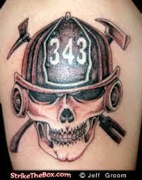 grey ink firefighter skull on shoulder