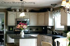 Above Kitchen Cabinet Decorations Top Cabinet Decorating Ideas Cabinet Decorating Ideas Top