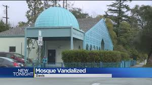 davis window and door bacon strips and broken windows at davis islamic center