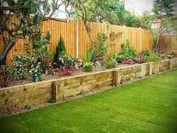 raised flower bed along fence garden along fence green