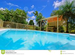 Backyard Swimming Pools by Swimming Pool And Palm Trees In The Backyard Stock Images Image
