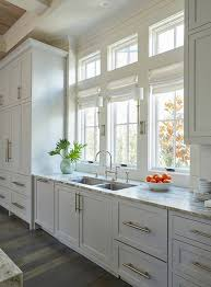 The Light Gray Kitchen Cabinets Are Adorned With Extra Long Satin - Long kitchen cabinets