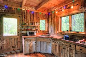 blue kitchen cabinets in cabin rustic cabin kitchen stock photo image now