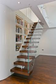 stair step bookcase wood floor stairs shelves books glass