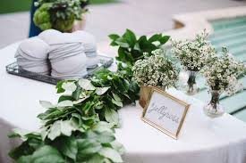 ceremony décor photos yarmulke table with greenery garland