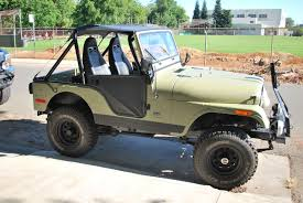 jeep wrangler unlimited half doors how to buy a classic jeep the complete buyer u0027s guide the drive
