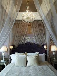 sparkling chandelier with black curvy headboard and stylish sheer