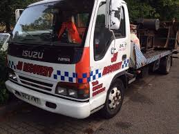 isuzu npr recovery truck with tilt and slide and spec lift in