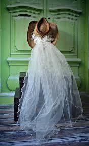 western wedding western wedding veil ivory white hat cowboy boots brid
