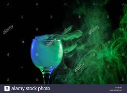 halloween background witch abstract art hookah blue green smoke in a cocktail glass on a