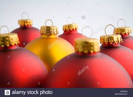 closeup of one gold tree bulb ornament stands out among