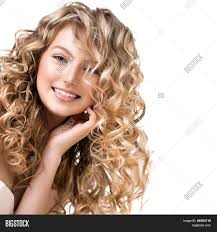 beauty with blonde curly hair healthy and long blond wavy