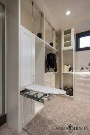 ironing board closet cabinet white and gray closet with hidden drop down ironing board closets