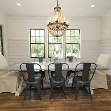tan beaded chandelier with round concrete top table transitional