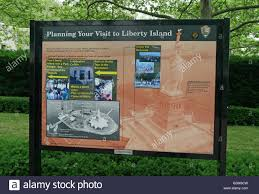 National Park Map Usa by Liberty Island National Park Map And Advertisements Sign On Lawn