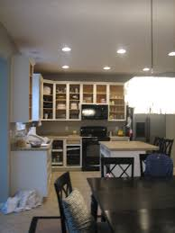 Professional Spray Painting Kitchen Cabinets by House Tweaking