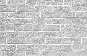 stone brick white brick stone wall seamless background and texture stock photo