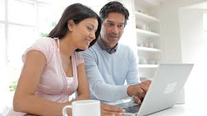 Technology At Home Couple Using Computer At Home Family Technology Concept Stock