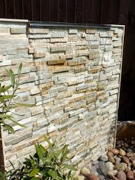 outdoor water wall featuring oyster split face slate maxi panel