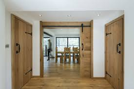 appealing house interior using rustic wooden indoor doors beside
