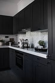 black kitchen cabinets with marble countertops 25 ultimate black kitchen designs that wow shelterness