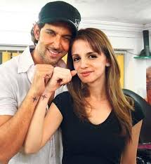 celebrity couple with small star tattoo designs on the wist tattoo