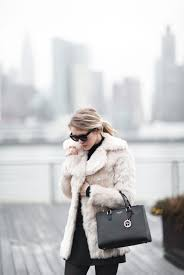 cheralee lyle in a faux fur coat from boohoo wanting dream