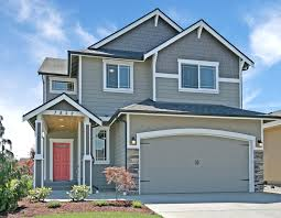 front doors beautiful garage pergola over carriage garage door door design grey exterior with white trim black gutters and a bold coral front door carriage style garage doors and stone accents make this a great