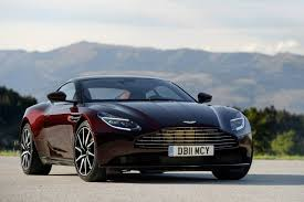 aston martin blacked out aston martin db11 looks divine in deep wine red