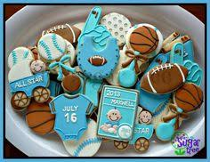 sport themed baby shower sports baby shower cookies find baby rattle here https