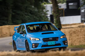 subaru sports car wrx tackling goodwood hill in a right hand drive subaru wrx sti