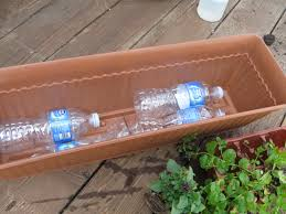 i fill up my planter boxes u0026 large containers with plastic bottles