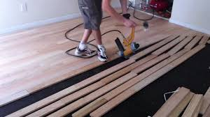 Installing Laminate Flooring Youtube Flooring How To Install Nail Down Unfinishedod Floors Youtube