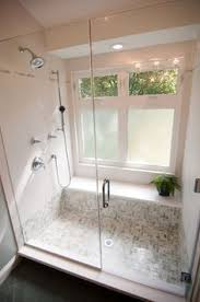 windows in the shower with bottom ones frosted i like the bench
