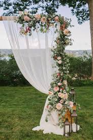 wedding arch garland ceremony arbor with fabric and eucalyptus garland and