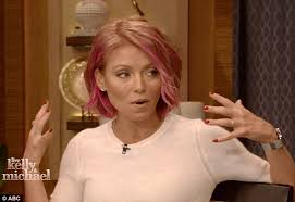 how do they curl kelly rippas hair kelly ripa teams candy coloured hair with coral skirt and