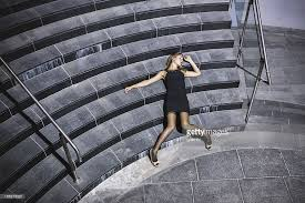 dead young woman lying on the concrete stairs stock photo getty