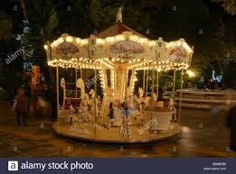 childrens carousel lit up at in the parque de la alameda