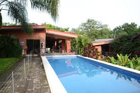 house with guest house and swimming pool tropical garden in the