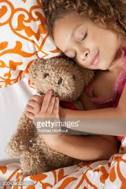 Bed Eyes Sleeping In Bed Hugging Teddy Bear Elevated View Stock Photo