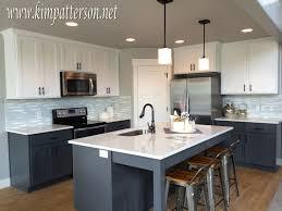 dark lower cabinets light upper cabinets kitchen cabinets light on