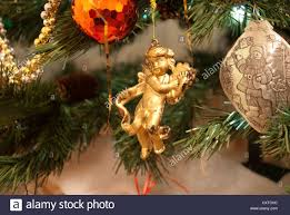 close up of old gold cherub playing harp christmas decoration