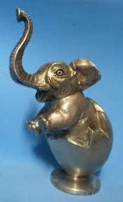 1920 elephant in egg car mascot hood ornament re pin brought to